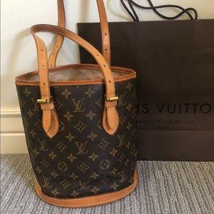 Authentic Louis Vuitton monogram petit bucket bag